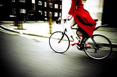 red-coat-girl-on-bike